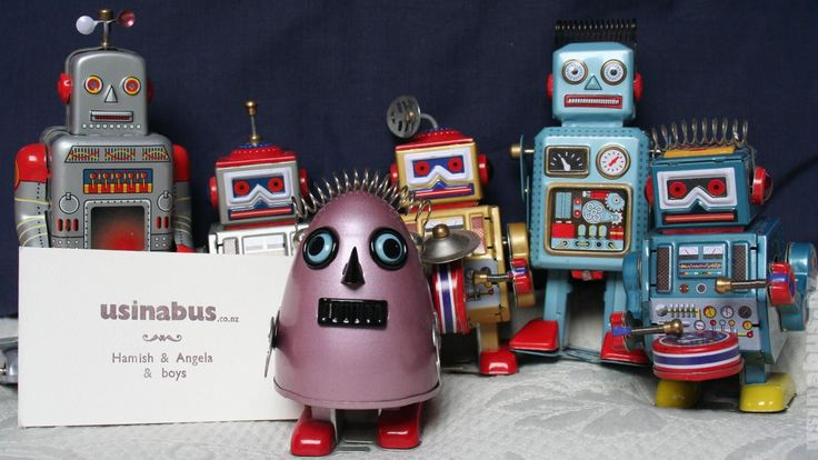 Family travel blog. These tin robots managed to stow away with us for the ride.  Us in a bus.