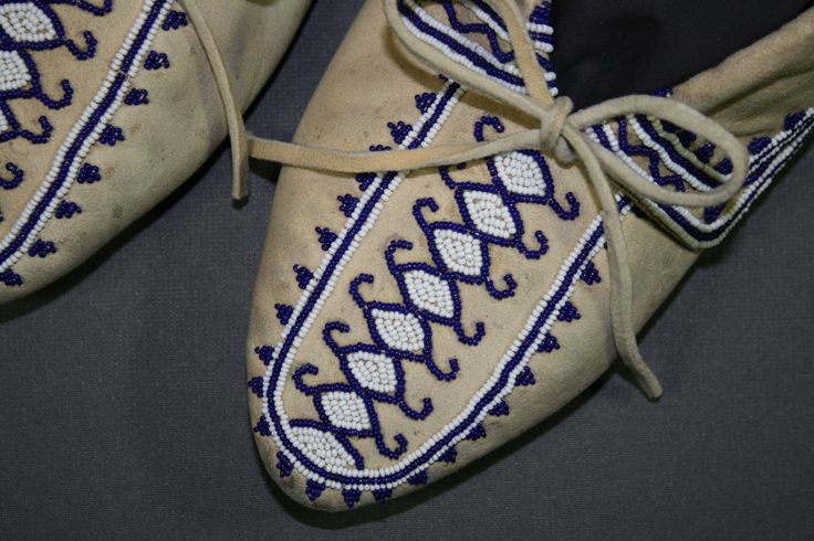 Moccasins made of leather featuring glass beadwork.  The  moccasins were cleaned, conserved and stabilized at Spicer Art Conservation, specialists in the restoration and conservation of textiles, objects and paper artifacts. Collection of RMSC.