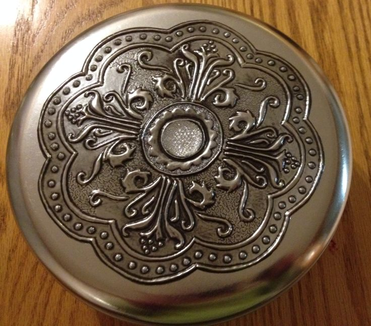 Pewter decorated tin by Heather van den Bergh