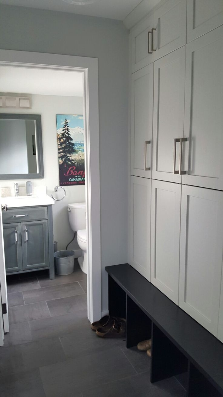 Storage Lockers in 1974 Renovation. This space was previously occupied by a hallway laundry area and transformed into a family storage area. Refinished powder room. Benjamin Moore Wickham Gray.