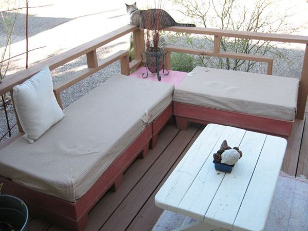 DIY Pallet Outdoor Sectional: She found plastic pallets but I would use painted wooded ones...the cushions were from a discarded couch and she used shadecloth to cover them. She even gives tips on how to clean/sanitize the cushions if their history is...unknown. She only spent $40! So want to do this for our back patio!