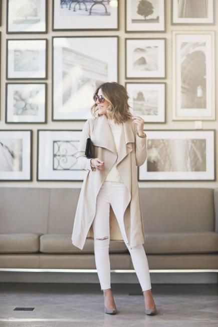 Stephanie of SS Life + Style keeps it neutral with white jeans, a cream sweater, and a beige trench coat. #Fashion #SpringStyle