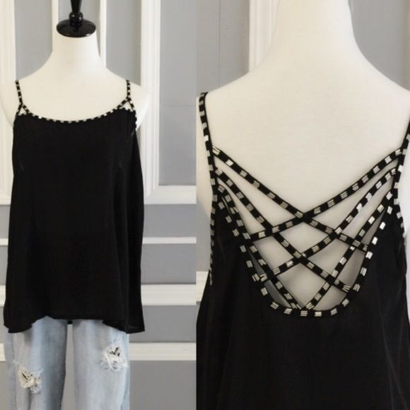 Super cute! Black Chiffon Tank with Beaded Details coming soon Super cute and sexy! Chiffon tank with criss cross back and beaded details.  Perfect to dress up or down! This will look Hot with skinny jeans and heels or perfect with sandals and shorts too! Please ask any questions.  Young contemporary fit, true to size.  Thank you! April Spirit Tops Tank Tops