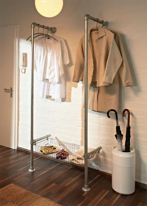 Use metal pipes from the hardware store and a wire mesh basket or two to create a DIY makeshift closet with pizzazz.