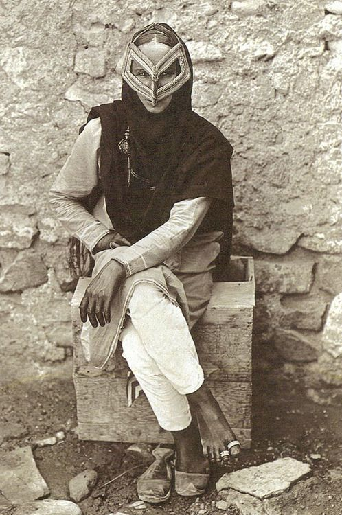 This is the colourful painted birqa, or falcon shaped face mask that some traditional women in Oman veil with, but one rarely sees younger women wearing these unless for weddings with full-out cultural gear. ! Oman, 1917. National Geographic.