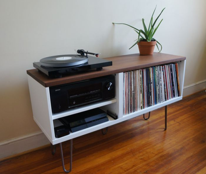 "A ""IKEA BESTA"" was cut down to accommodate records and a receiver. Topped with Brazilian hardwood and hairpin legs were added. Via Ikea Hackers."