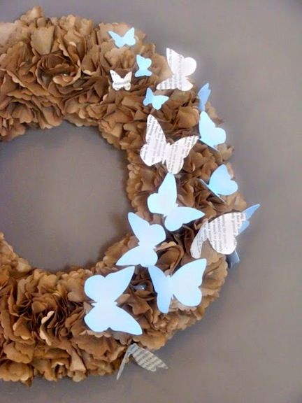 Spring Wreath: Use brown lunch bags to make the flowers, then glue onto a regular wreath form and add butterflies.