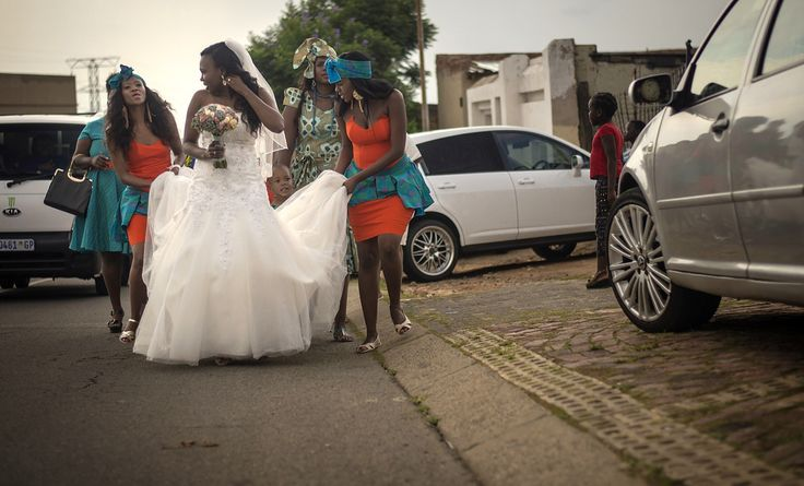 A street parade is the order of the day when a wedding takes to the township in South Africa..proudly South African