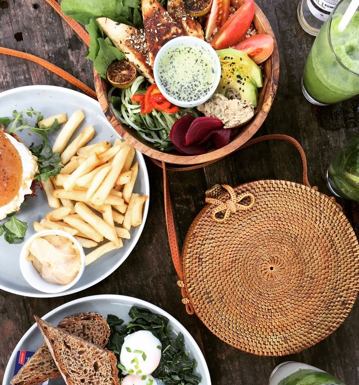 Brunching with our popular round, rattan basket bag - Daisy.