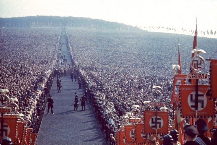 these photos are insane. Nazi rally, 1937 | A Brutal Pageantry: The Third Reich's Myth-Making Machinery, in Color | LIFE.com