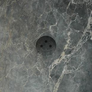 Plug-socket sunk in natural stone; there's no difference in the material. Furthermore the inside of the stone can have the same finishing layer as the surface of the stone.
