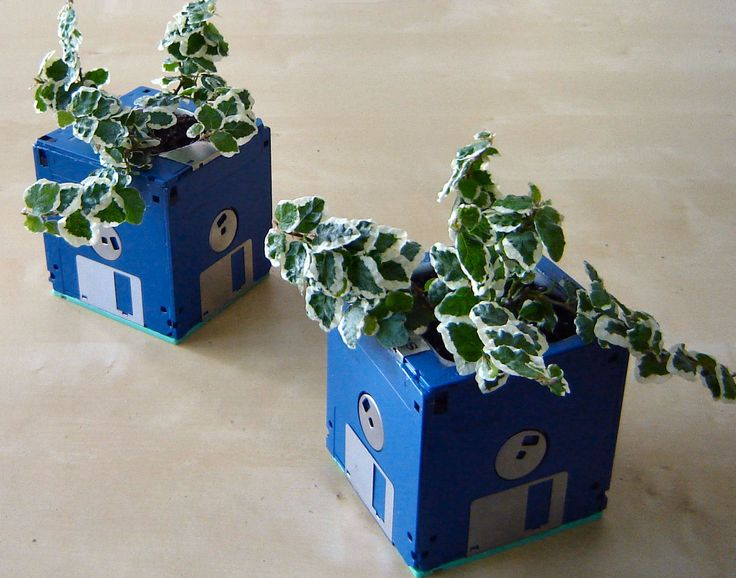 Floppy disk planters are a great way to use old floppy disks that you may have lying around.  They are made simply from floppies glued together to form a cube and adding a liner on the inside.