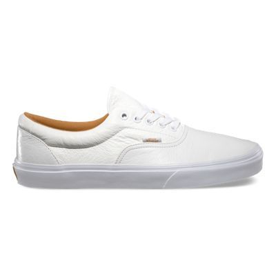The Premium Leather Era, Vans classic low top lace-up skate shoe, has a durable double-stitched premium leather upper with a padded tongue and lining, and Vans signature Waffle Outsole.