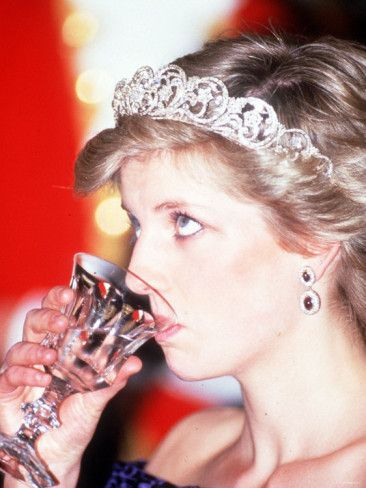 Very rare to photograph a royal either eating or drinking ~ even if it's only water!