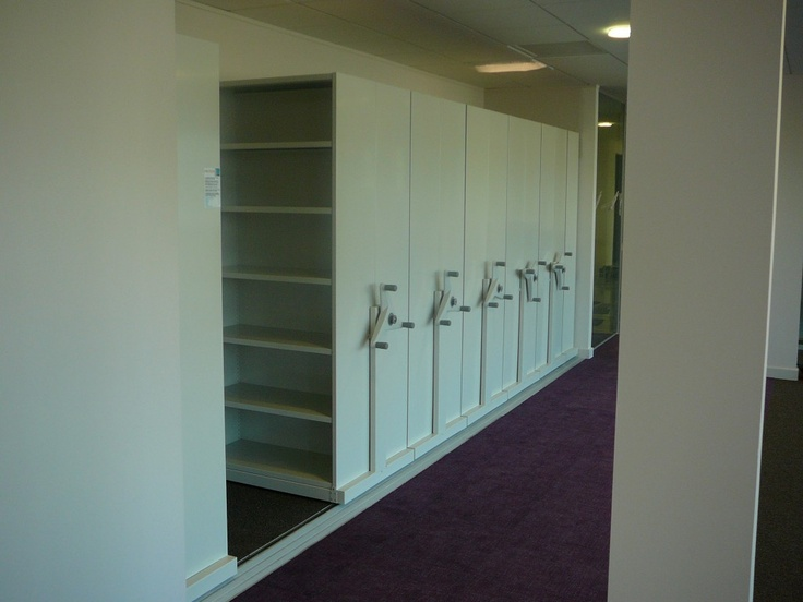 Flexistor is a floor-tracked mobile archive storage system for document archiving in office and warehouse buildings. http://www.compactstorage.co.uk/mobile-shelving/flexstor/