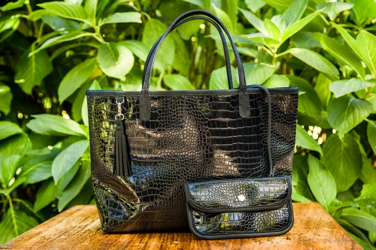 Nicole Martine Ritz Tote- Black patent tote with genuine tan leather handles and trim. Press stud closure, removable tan leather tassel and matching inner purse. www.nicolemartine.com/shop