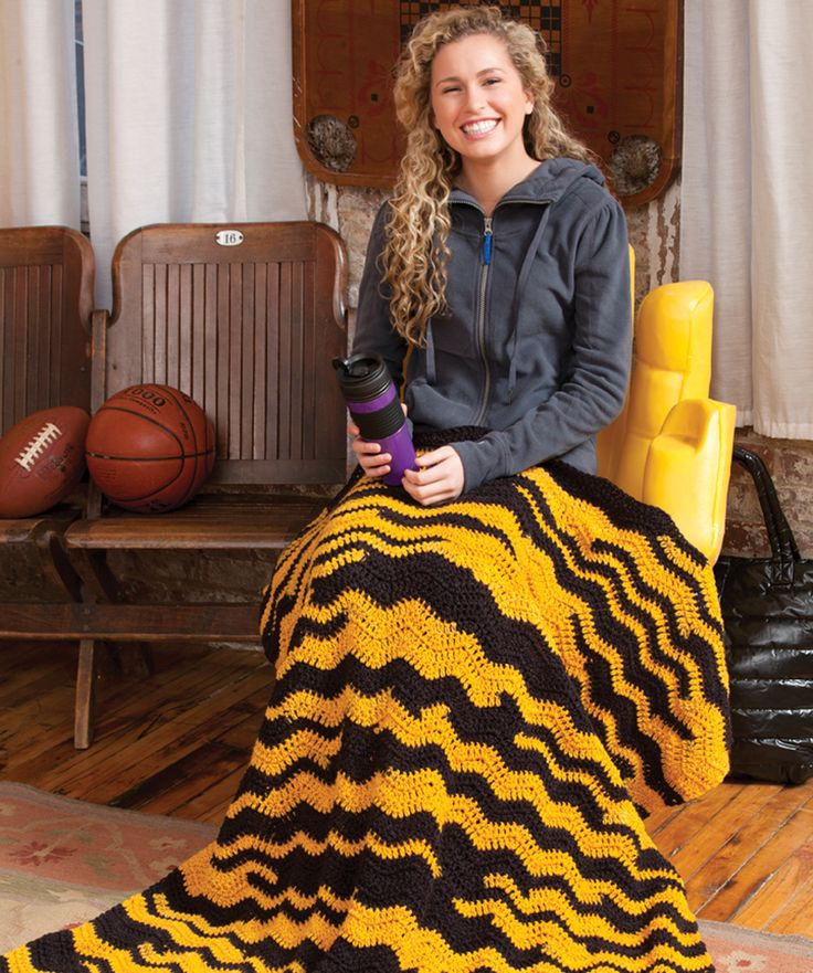 Take it to the game, use it in a dorm room or keep it on a favorite tv chair—this ripple throw shows your team's colors! It's easy to crochet thanks to the self-striping yarn and it's a great gift for any sports lover!