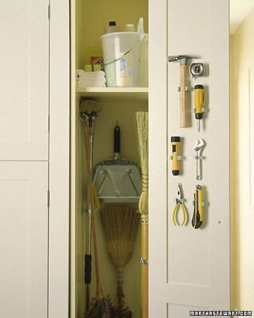 Broom Closet Organizer  Hooks and clips keep mops and brooms tidy and tools at hand.