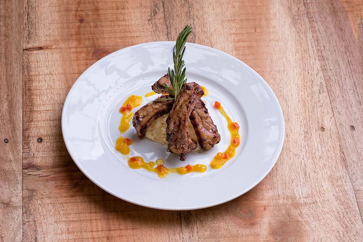 Coastal Pork Ribs over a yuca puree, covered with a mango chutney