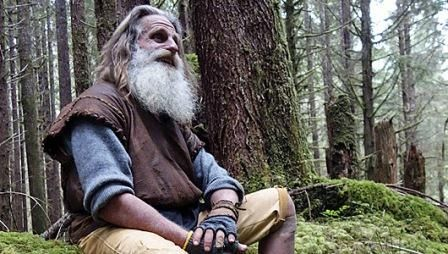 he lives in a tree, doesnt wear shoes and brushes teeth with a pinecone...