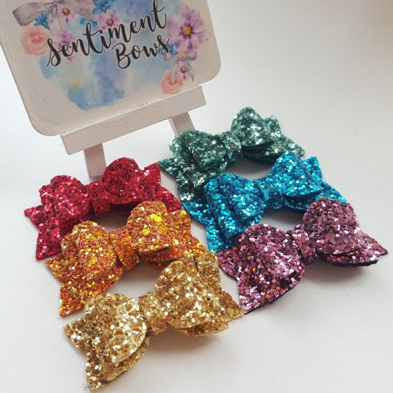 Hey, I found this really awesome Etsy listing - Gorgeous rainbow bows!   https://www.etsy.com/uk/listing/510378903/rainbow-glitter-clips-fringe-clips