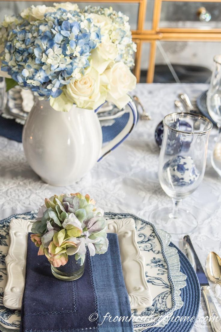Hydrangea-Inspired Blue and White Table Setting   If you're looking for Easter dinner or spring table ideas, this blue and white table setting has a hydrangea centerpiece that is perfect for the occasion. The blue and white place setting is really pretty, too.