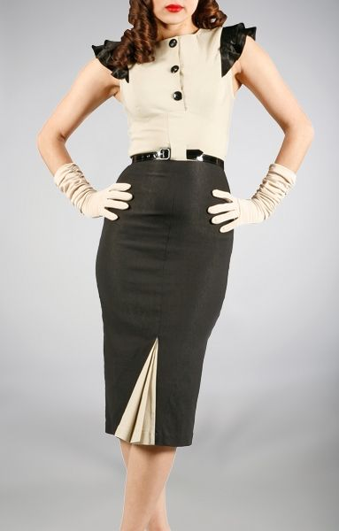 I really like the idea of this pencil skirt with kick-pleats in a different colour.  The top is not bad too.  Not sure how I feel though how the skirt fits on this model in the front of the skirt at the top bunching a lil' on her.   Overall, great vintage look though!