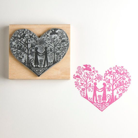 This beautiful handmade stamp is mounted on a wooden handle.  This stamp has been very popular for wedding invitations and anniversaries.  Or it