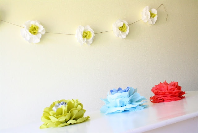Wallflowers   MADE -- napkin flower w/a variation of size/color as well as hanging method.