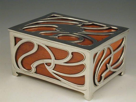 Manufacturer WMF, Designer unknown, Pewter and wood cigarette box, Germany, c.1905 http://www.titusomega.com/Object%20Profile%20and%20Photos/Old%20profiles/Metalware/wmf_box_115.htm