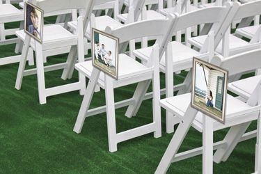 Wedding Chair Photos - Hang photos of you and your fiancé in antique frames from the chairs down the aisle.