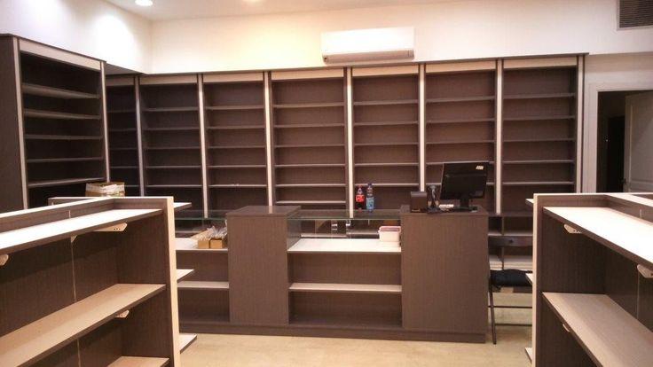 Mobiliario comercial - Herbolario Madrid - Cremalleras - Góndolas centrales - Mobiliario de madera - Mostradores - Vitrinas