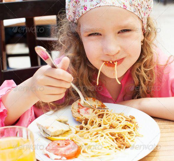 Child eating pasta. http://photodune.net/item/child-eating-pasta/6614989