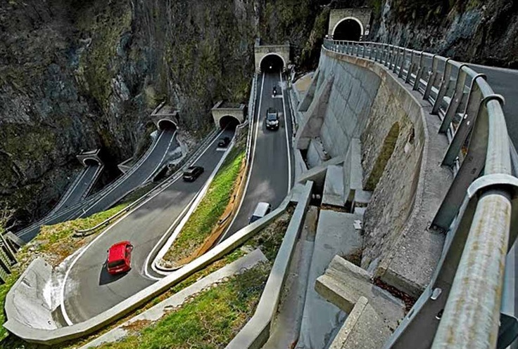 The Passo San Boldo is a small mountain pass in the region of Veneto, Italy. The passage is in the southern Alps and connects Belluna Val > Mareno Val n a height of 706 m. The mountain pass is named SP 635 and has only one runway. The traffic is regulated by several sets of lights. There is a speed limit of 30 km/h and a maximum height of 3.2 meters. There are five tunnels dug into the rock with sharp turns and six bridges. The road was built in 1918 in just three months.