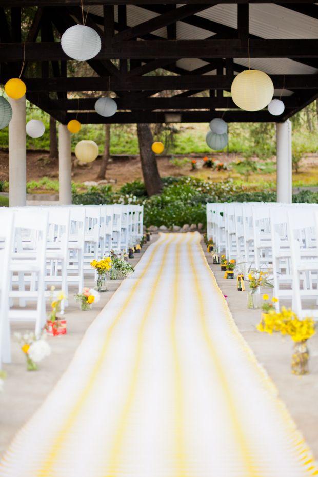 adorable runner + jars & crates w/ flowers + yellow & gray lanterns | Justina Blakeney