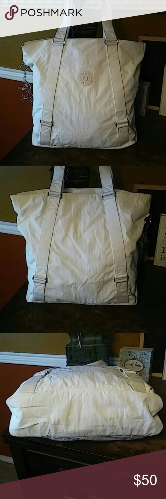 """Kipling Work Tote Super functional tote. One strap has gotten a little dirty in storage and a small area has a little discoloration that is very faint on the back. Zipper compartment in the center. Velcro closure. Easy clean wipeable material. 9"""" strap drop. 16x13x5. Should fit most laptops, tablets or ipads. Kipling Bags Totes"""