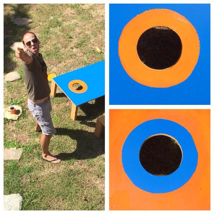 Putting the finishing touches on cornhole.
