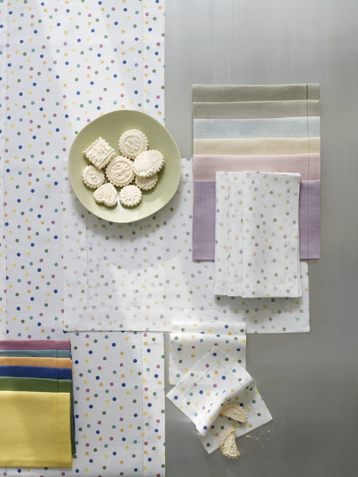"Inspired by the ""Spot"" paintings of Damien Hirst"", SFERRA's Bolero printed linen in two different color palettes, bright or pastel. Shown with solid-color Festival linens to mix-and-match."