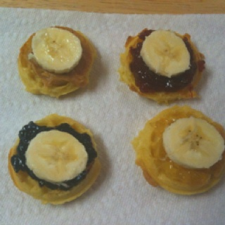 Made this for my son for breakfast this morning. It's a fun & healthy way to eat mini-waffles. Eggo MINIS waffles, fruit preserves or peanut butter spread on the waffle and a sliced banana disc on top! He LOVED it!
