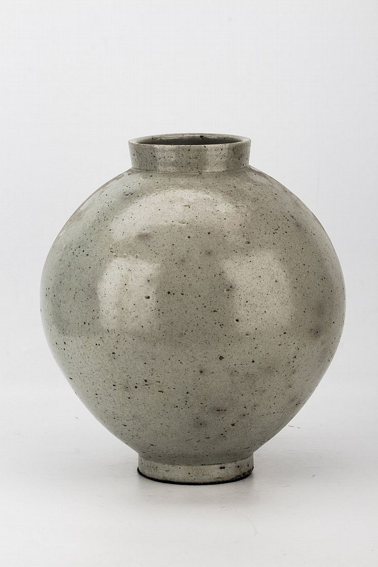 (Qing dynasty) White Glazed Porcelain Vase of globular form with inverted mouth and base. ca 18th century CE. 35× 39cm. Qing dynasty, China.