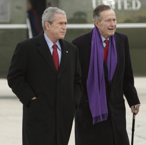 President George W. Bush walks with his father, former President George H.W. Bush,