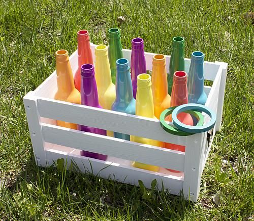 Recycled Bottle Ring Toss Backyard Game -- Take the fun and games outside this summer.  #decoartprojects