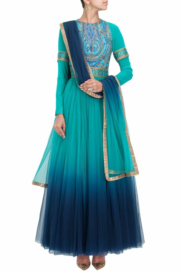 This anarkali suit features in a turquoise to midnight blue ombre tulle anarkali with digitally printed hand embroidered bodice and panel on lycra net sheer sleeves. This anarkali has satin cuffs deta