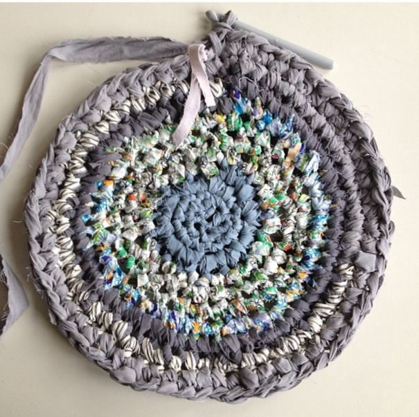 A classic rag rug (or plastic breadwrapper mat)