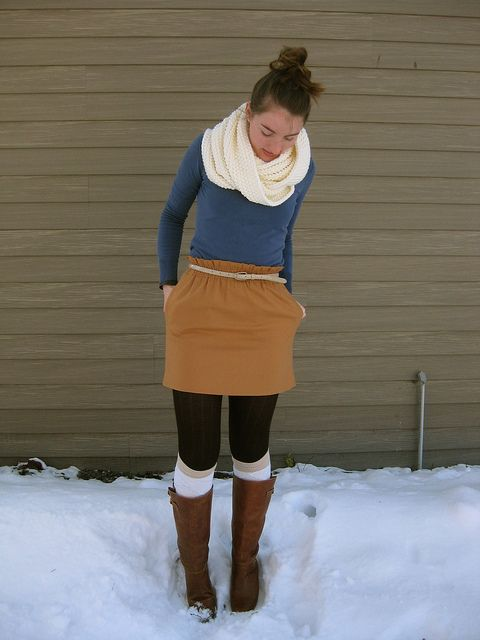 i love her winter style! i will wear tights and skirts in the snow.