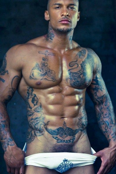 David Mcintosh...love this picture: symmetrical tats framing his hard shiny muscles and the maximum display right down to the lower limit