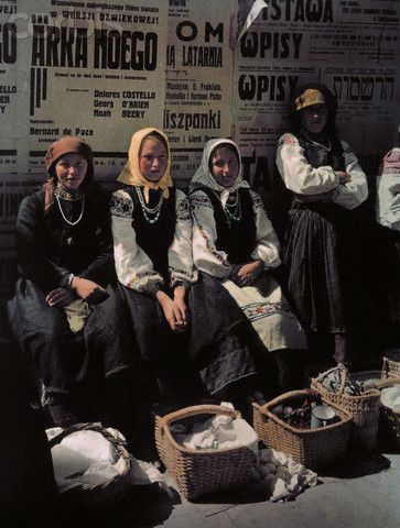 A group of women take a break from selling goods at the market. Poland. 1935.