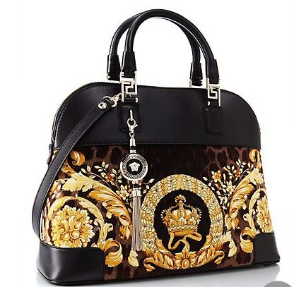 "This beautiful Versace purse is called ""Vanitas"" Athena Velvet Handbag. The soft velvet is paired with a baroque print. It costs $2,540."
