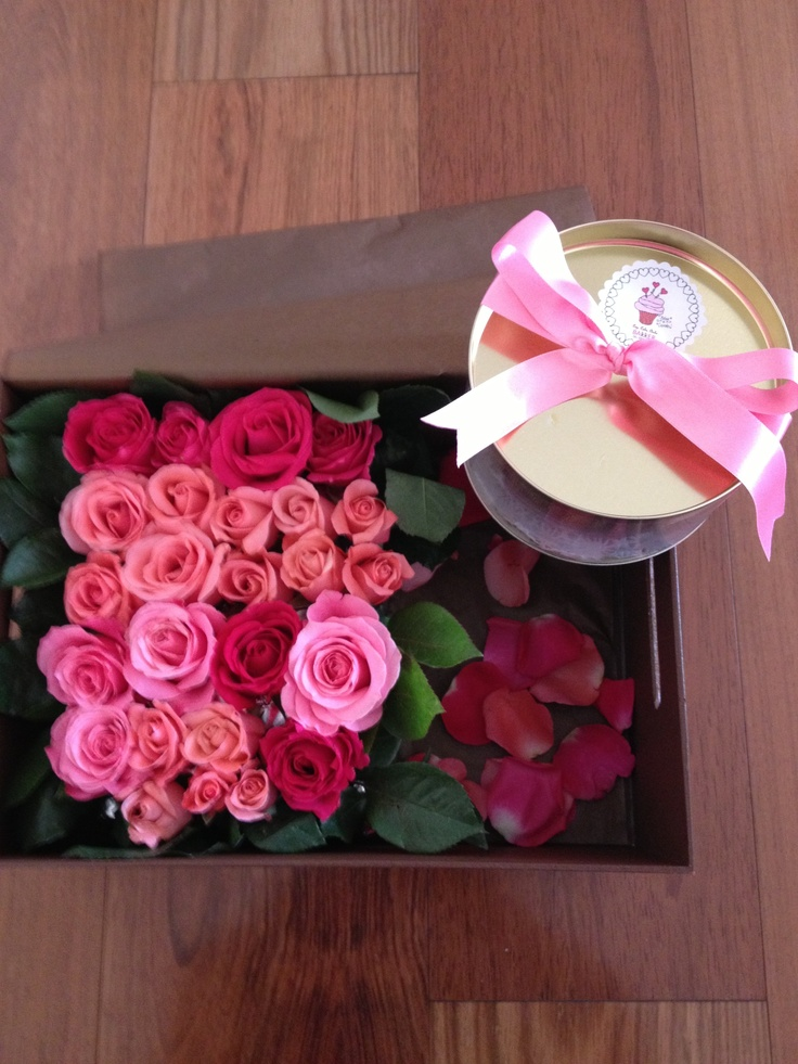 Box with cake and fresh flowers