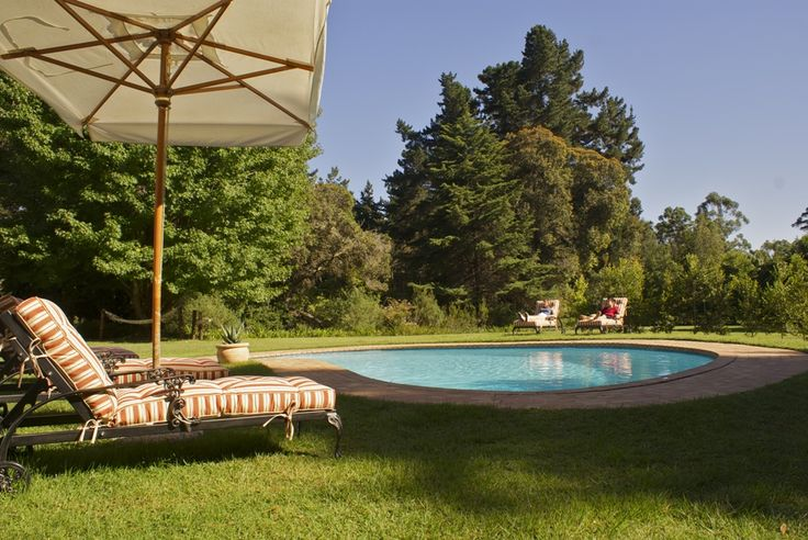 Edenbrook is situated in a part of the Garden Route called Eden. Between Knysna and Plettenberg Bay, a gracious colonial style house with manicured gardens, and orchards, immersed in 20 hectares of pristine forest with a stream running through the bottom of the property – hence the name. | Holiday Houses SA